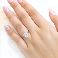 Oval moissanite ring in rose gold halo diamond ring setting east west engagement ring by la more design jewelry