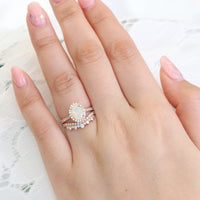 oval opal ring and crown diamond wedding band in rose gold halo diamond bridal set by la more design