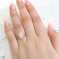 oval opal ring and curved diamond wedding band in rose gold halo diamond bridal set by la more design