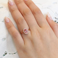 oval peach sapphire engagement ring in rose gold halo diamond band by la more design