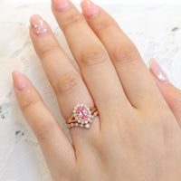 oval peach sapphire ring and curved diamond band bridal set in rose gold by la more design