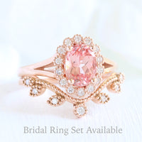 oval peach sapphire ring and curved diamond band in rose gold bridal set by la more design