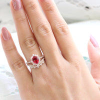 oval ruby engagement ring rose gold halo diamond bridal set and crown diamond wedding band by la more design jewelry