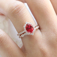 oval ruby engagement ring rose gold halo diamond bridal set and diamond wedding band by la more design jewelry