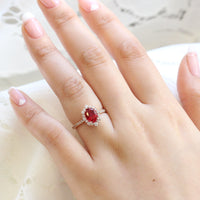 oval ruby engagement ring rose gold halo diamond ring low profile ring by la more design jewelry