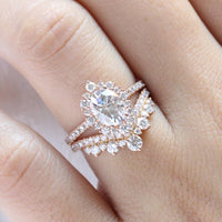 oval moissanite engagement ring rose gold halo diamond bridal set and contour diamond wedding band by la more design jewelry