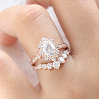 oval moissanite engagement ring rose gold halo diamond bridal set and curved large diamond wedding band by la more design jewelry