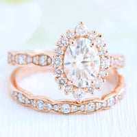 oval moissanite engagement ring rose gold halo diamond bridal set and diamond wedding band by la more design jewelry