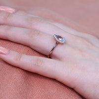pear aquamarine engagement ring rose gold halo diamond band by la more design