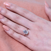 rose gold pear aquamarine halo diamond engagement ring by la more design