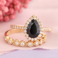 pear black spinel engagement ring set yellow gold milgrain wedding band by la more design