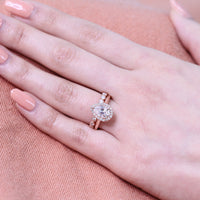 Rose gold halo bridal set pear moissanite ring and milgrain diamond band by la more design