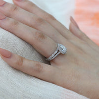 white gold pear moissanite engagement ring bridal set and scalloped diamond band by la more design