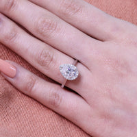 white gold pear moissanite halo diamond engagement ring by la more design