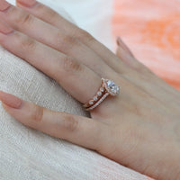rose gold pear moissanite engagement ring bridal set and milgrain diamond wedding band by la more design