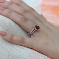 rose gold bridal set pear ruby ring and scalloped diamond wedding band by la more design