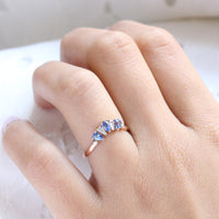 pear and baguette diamond and sapphire ring rose gold curved wedding band by la more design jewelry