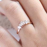 pear and baguette diamond ring rose gold curved wedding band by la more design jewelry
