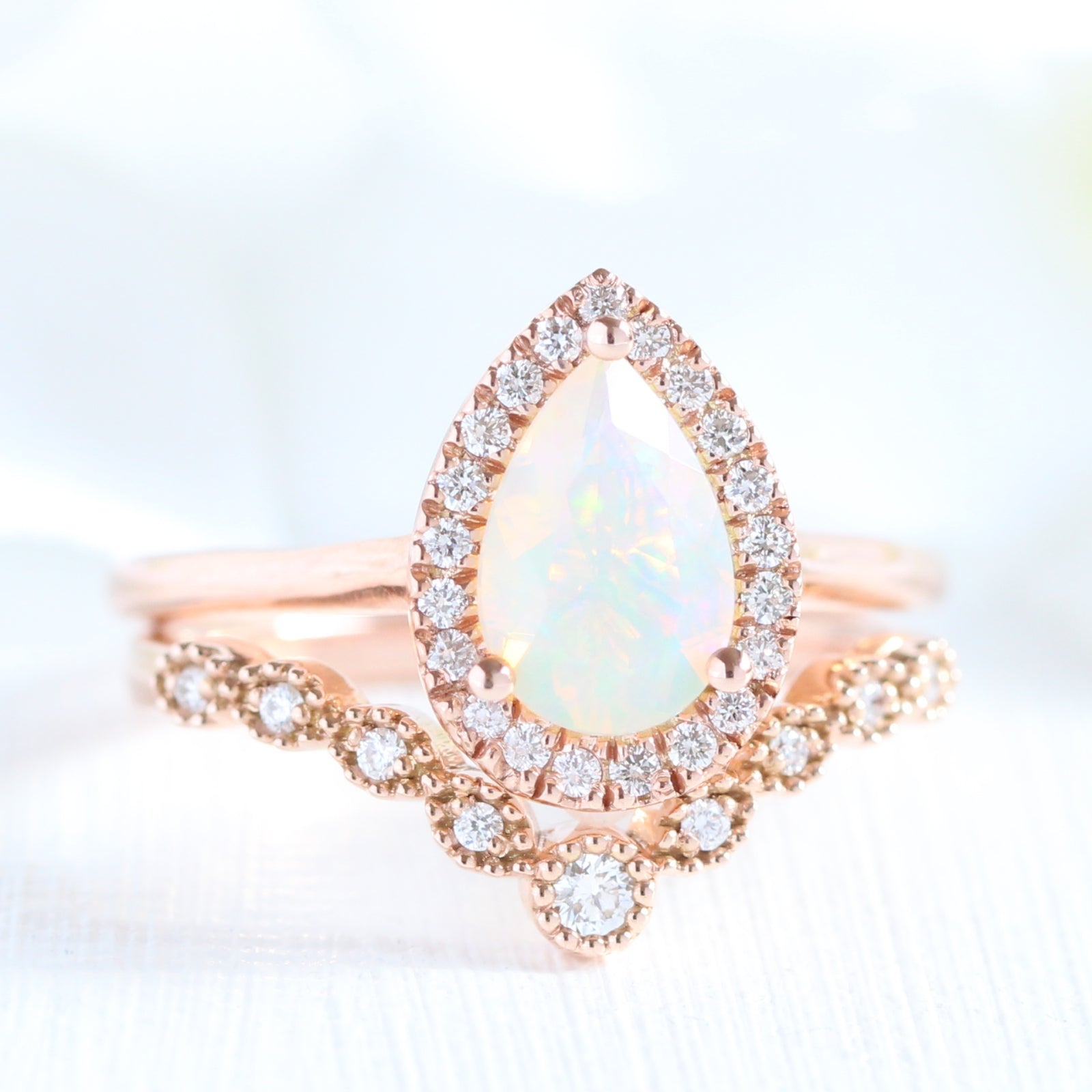 pear_cut_opal_ring_and_curved_diamond_we