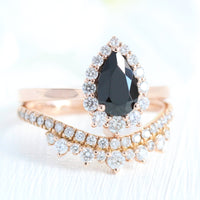 pear engagement ring rose gold black diamond halo ring and salt and pepper grey diamond wedding band by la more design jewelry