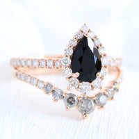 pear engagement ring rose gold halo black diamond ring and grey salt and pepper diamond wedding band by la more design jewelry