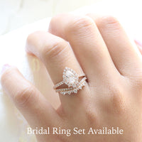 pear moissanite engagement ring rose gold and curved crown diamond wedding band by la more design jewelry