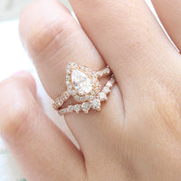 pear moissanite engagement ring rose gold bridal ring set curved diamond wedding band by la more design jewelry