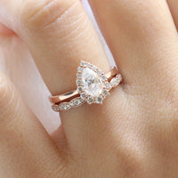 pear moissanite engagement ring rose gold halo diamond ring and matching diamond wedding band by la more design jewelry