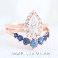 pear moissanite halo diamond engagement ring rose gold and large sapphire wedding band by la more design jewelry