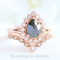 pear rose cut black diamond ring rose gold and curved diamond wedding ring set by la more design