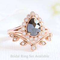 pear rose cut black diamond ring rose gold and curved leaf diamond wedding ring set by la more design