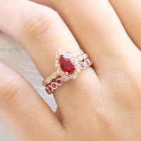 pear ruby diamond engagement ring rose gold bridal set and bezel ruby wedding band by la more design jewelry