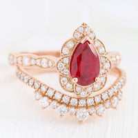 pear ruby engagement ring rose gold and curved crown diamond wedding band vintage style bridal set by la more design jewelry