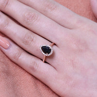 rose gold black spinel engagement ring diamond halo pear ring by la more design