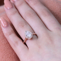 rose gold pear moissanite halo diamond engagement ring by la more design