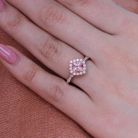 halo diamond peach sapphire engagement ring in rose gold scalloped band by la more design