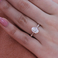 oval moissanite solitaire engagement ring in rose gold scalloped diamond band by la more design