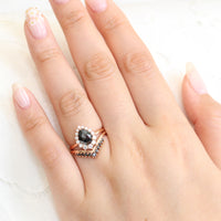 rose gold pear rose cut black diamond ring and v shaped diamond wedding ring set by la more design