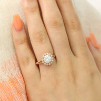 round moissanite ring in rose gold vintage halo diamond band by la more design