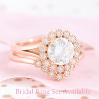 round moissanite ring set in rose gold vintage halo diamond band by la more design