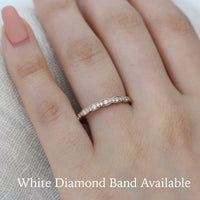 White diamond wedding ring in rose gold scalloped band by la more design