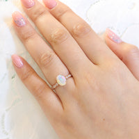 solitaire opal engagement ring in rose gold scalloped diamond band by la more design
