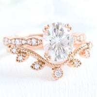 solitaire moissanite ring bridal set in rose gold curved leaf diamond band by la more design jewelry