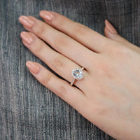 oval aquamarine engagement ring in rose gold vintage inspired band by la more design