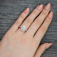 oval moissanite engagement ring in white gold vintage inspired band by la more design