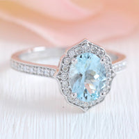 vintage floral oval aquamarine engagement ring white gold milgrain diamond band by la more design jewelry