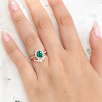 vintage inspired emerald ring and curved 7 stone diamond wedding band in rose gold bridal set by la more design jewelry