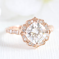 vintage inspired moissanite engagement ring in rose gold diamond band by la more design