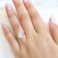 vintage inspired pear moissanite engagement ring in rose gold diamond scalloped band by la more design jewelry