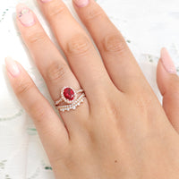 vintage inspired oval ruby ring and crown diamond wedding band in rose gold bridal set by la more design jewelry